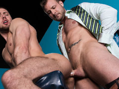 Football stud Brendan Phillips is on the interrogation table, ready for his routine physical. When the interrogation moves down south, Brendan can't suppress his excitement, and his cock leaps to attention at Doctor Austin Wolf's touch. A touch of Brendan