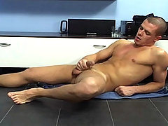 Sensual guy touching himself in his living room and cum