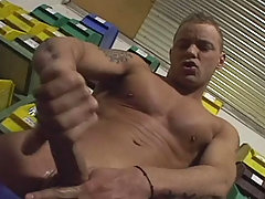 Handsome muscular stud enjoys himself at work and cum